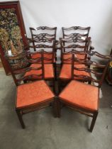 A set of six early 19th century dining chairs (two carvers), with pierced top rails and ladder