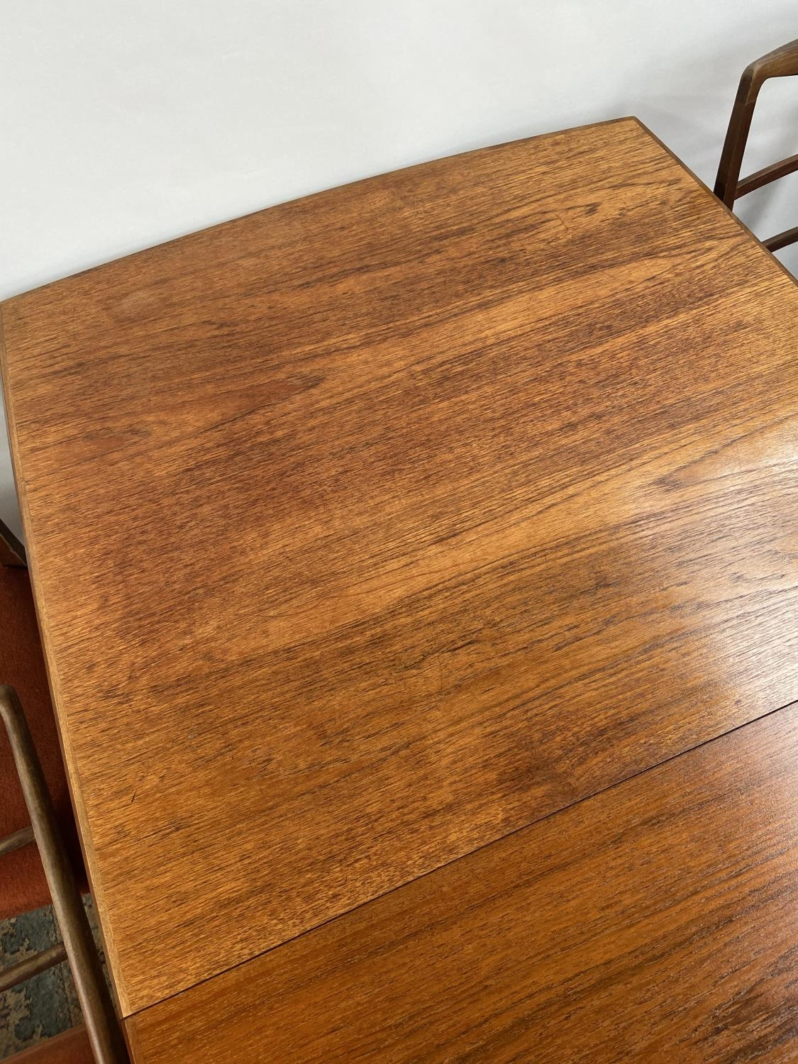 A Retro mid century teak dining table and four matching chairs produced by Vanson. [Table extended - Image 7 of 13