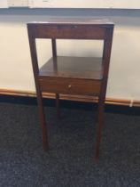A Georgian mahogany two tier table with single underdrawer to the middle, supported on straight