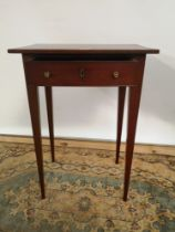 A Georgian side table supported on tapered legs and fitted with a single drawer [67.5x48x32.5]