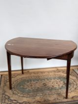 A Georgian drop leaf table with single line inlays on tapered supports