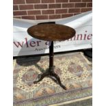 Queen Anne walnut candle stand (early 18th century) circular top above a slender ring-turned