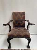 A 19th century carver arm chair, supported on claw and ball feet. [back 95cm] [seat area 47cm]
