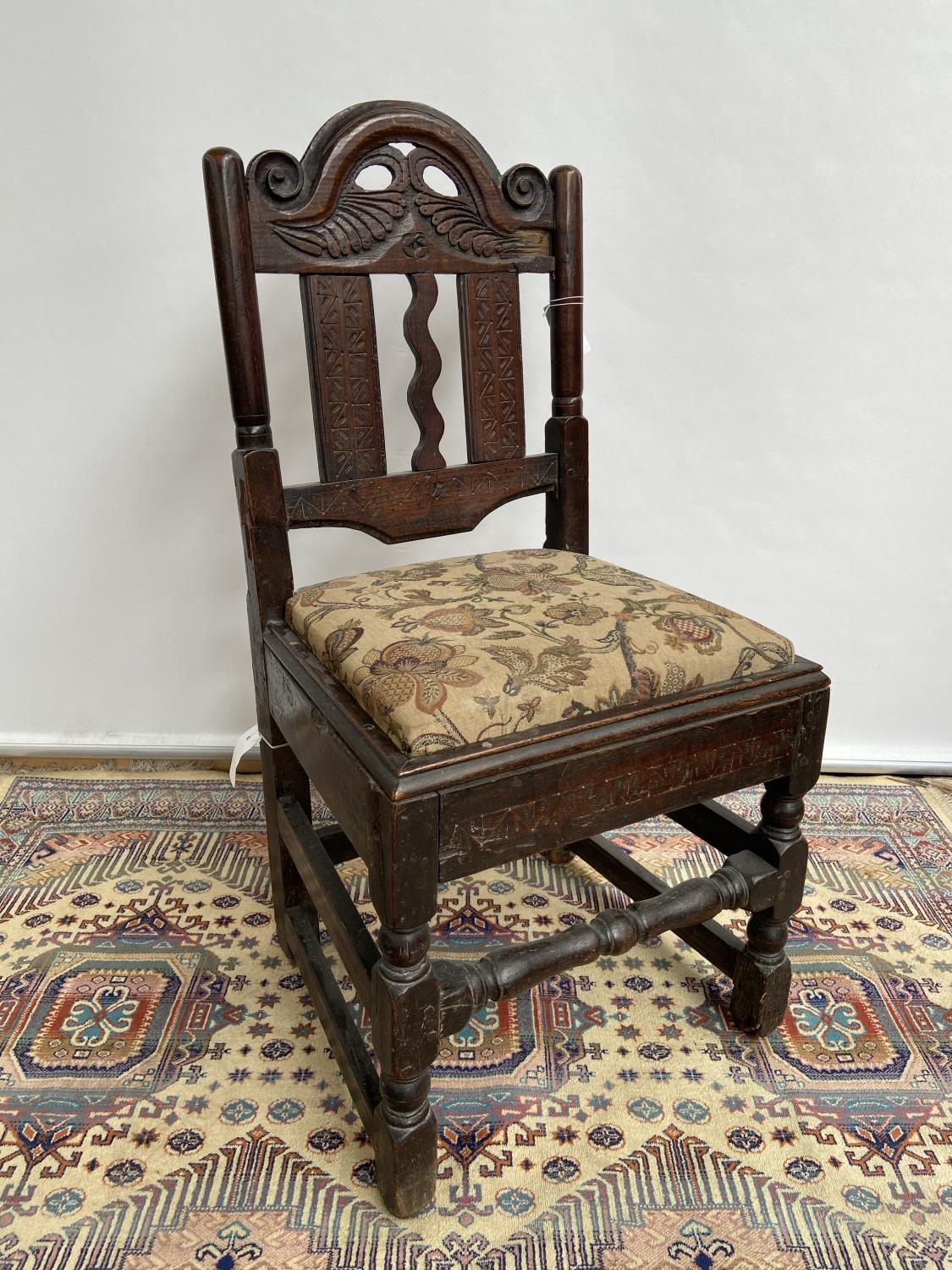 French carved walnut side chair [early 18th century] with a scroll-carved top rail above carved wavy