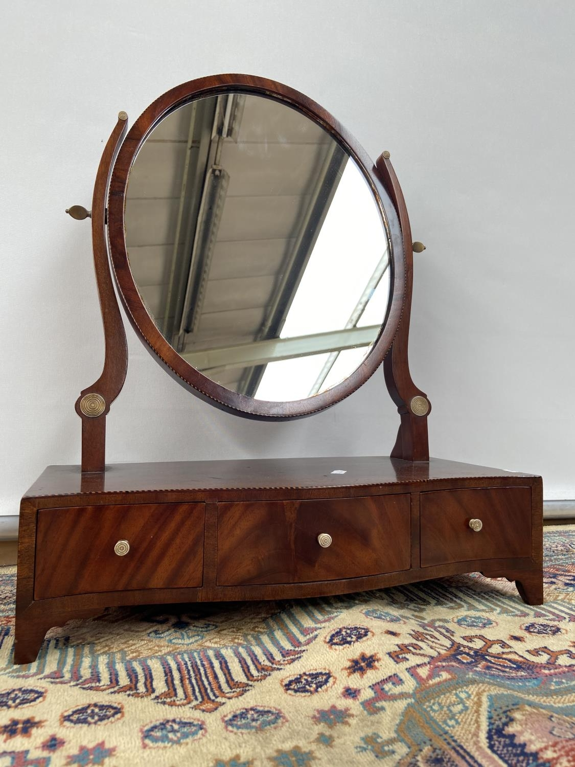 A Victorian dressing table mirror, upon a 3 drawer platform, detailed with ivory handles and a twist