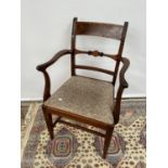 A regency parlour chair, waved arm supports with scroll detail to the end, upon tapered legs with