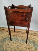 A Georgian side cabinet with single line inlay, tray effect top, raised on tapered legs, opening