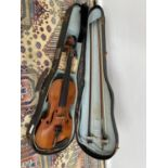 An antique violin, with two bows and carry case