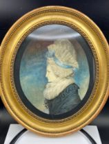 An Antique watercolour portrait of an old lady. Details to the back of the picture. Only two
