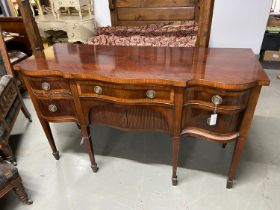 Georgian Style Mahogany Serpentine sideboard. A Serpentine top above a central frieze drawer and