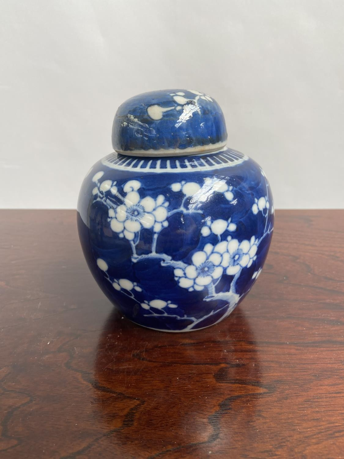 A Chinese blue and white preserve pot with lid, designed with cherry blossoms & double ring