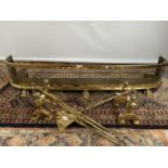 A Victorian gilt brass fire fender, styled with pierced from and claw foot supports, together with a