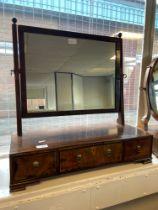 A Georgian mahogany adjustable dressing table mirror upon a three drawer base