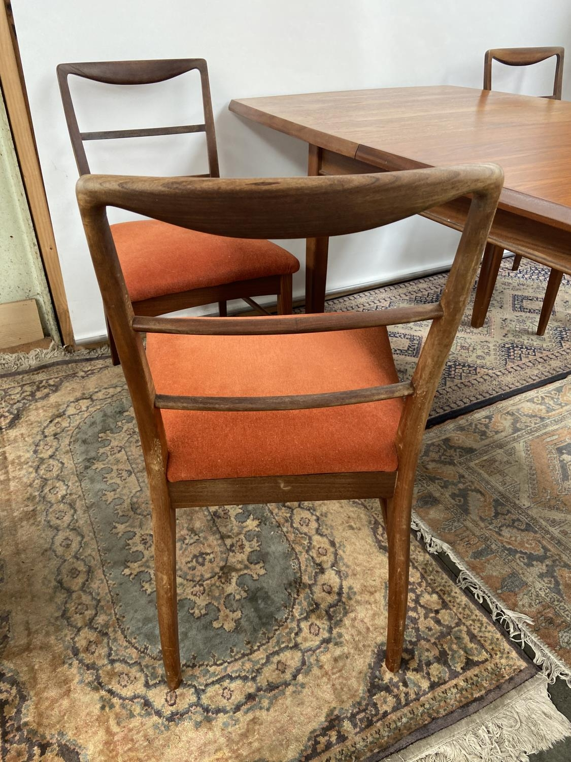 A Retro mid century teak dining table and four matching chairs produced by Vanson. [Table extended - Image 5 of 13