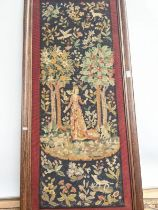 A 19th century rectangular oak framed tapestry, telling the story of a lady of importance surrounded