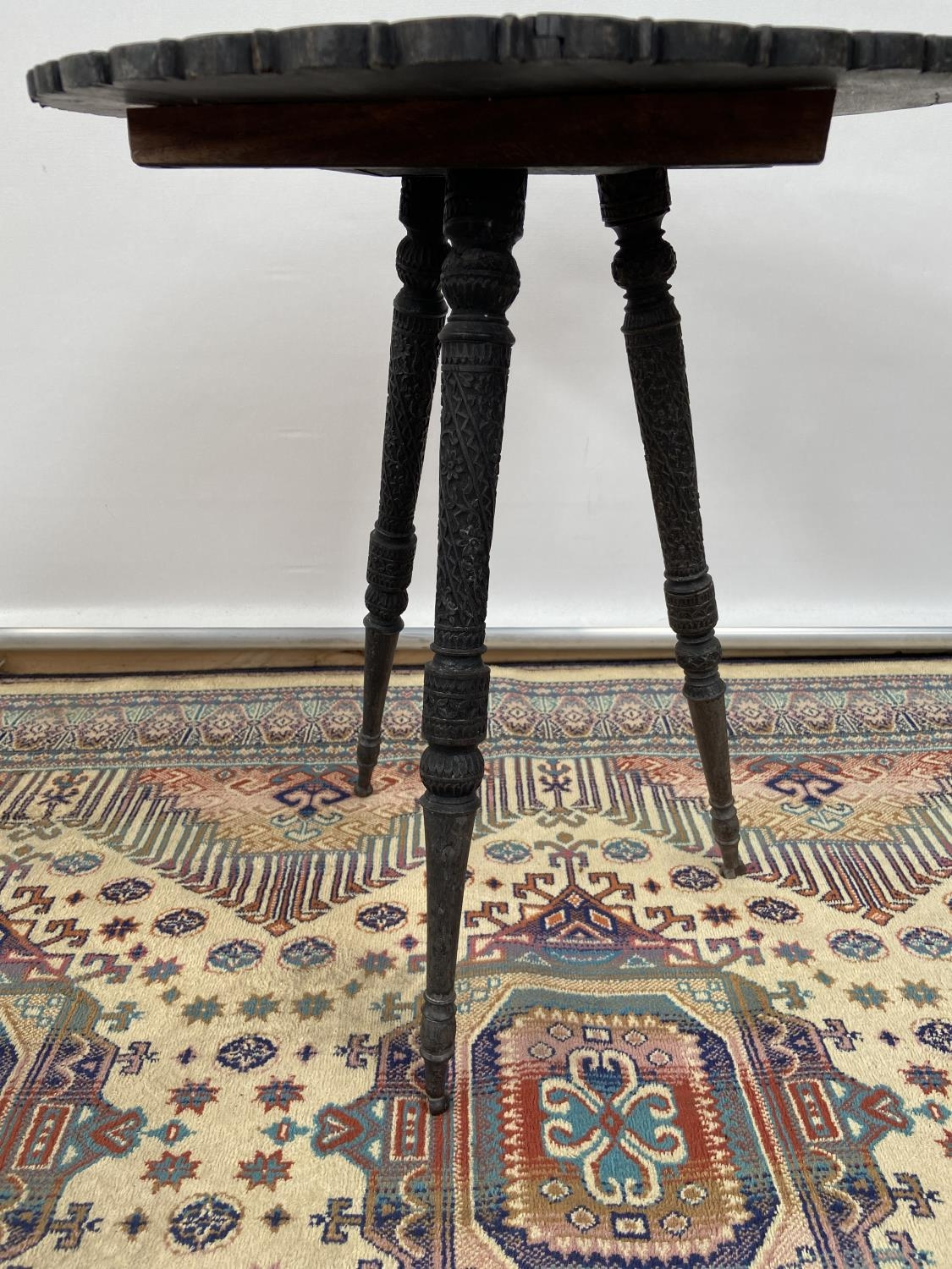 A hand carved hardwood oriental table, upon a tripod leg [height 48cm, diameter, 43cm] - Image 3 of 4