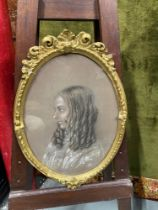 An original 19th century charcoal portrait drawing of a young lady signed Katharine Drake April