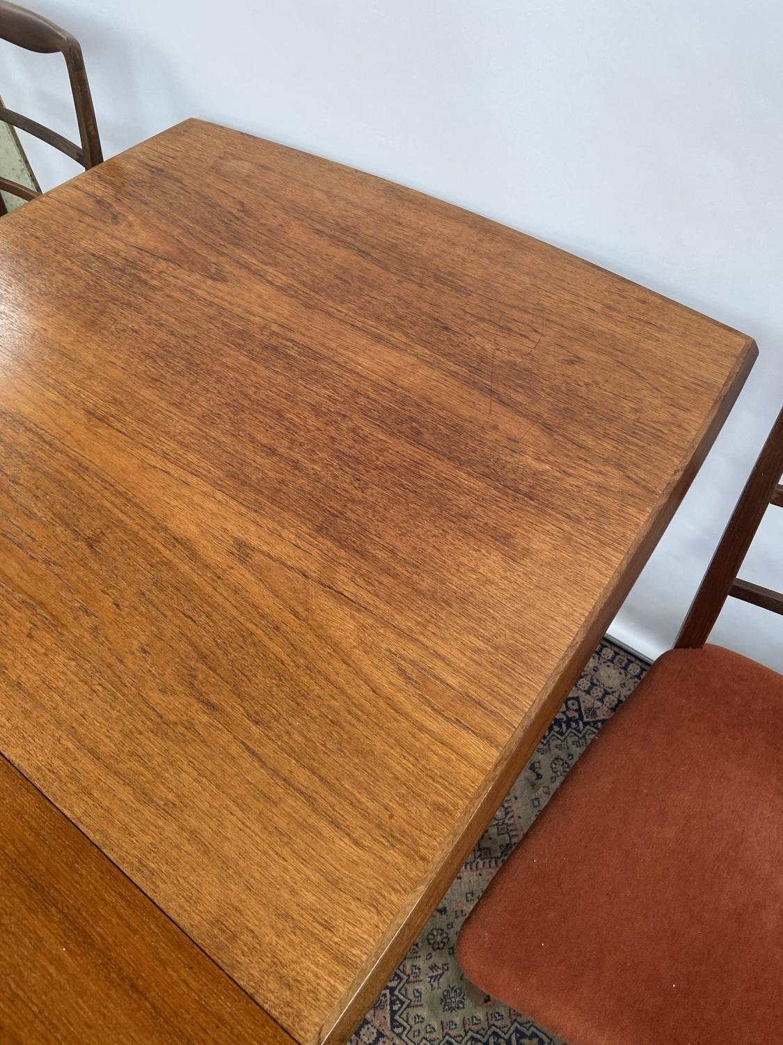 A Retro mid century teak dining table and four matching chairs produced by Vanson. [Table extended - Image 11 of 13