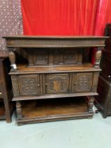 An Impressive 17th Century style oak court cupboard unit. Showing detailed carved panel doors and