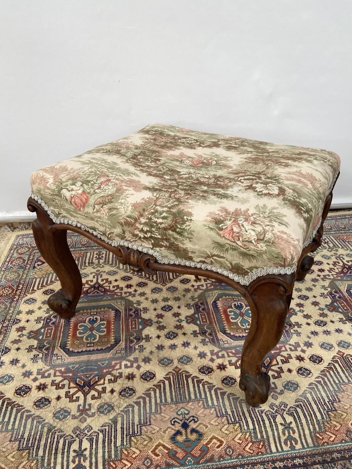 Victorian stool, upon four scroll design feet, upholstered tastefully [height, 40cm, width 56cm,
