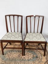 A lot of two Georgian armchairs, with three splat back, supported on tapered legs with a middle