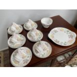 A 21 Piece vintage Shelley tea set titled 'Columbine' comes with cake plate, sugar and cream.