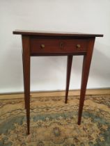 A Georgian side table, one centre drawer, supported on four tapered legs