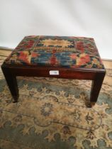 A 19th century mahogany stool, supported on four tapered legs upon castor feet [length, 43cm,
