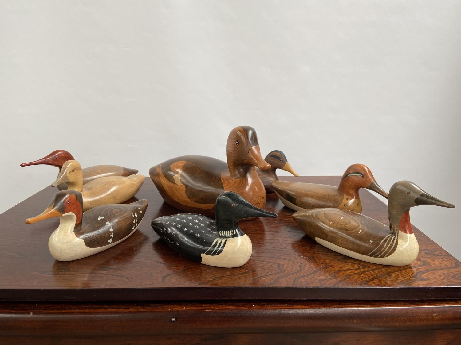 A Collection of hand carved wooden duck decoy sculptures by Jim Harkness.
