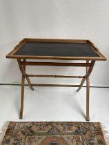 A 19th century folding writing desk. [Height 81cm] [82.5 x 60cm]