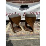 A pair of art deco design side tables, each carved from an individual piece of solid teak [