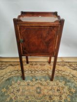 A Georgian side cabinet with single line inlay, raised on square straight legs, opening to the