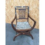 A Georgian inlaid campaign chair with an oval design square splat with a back to back half moon