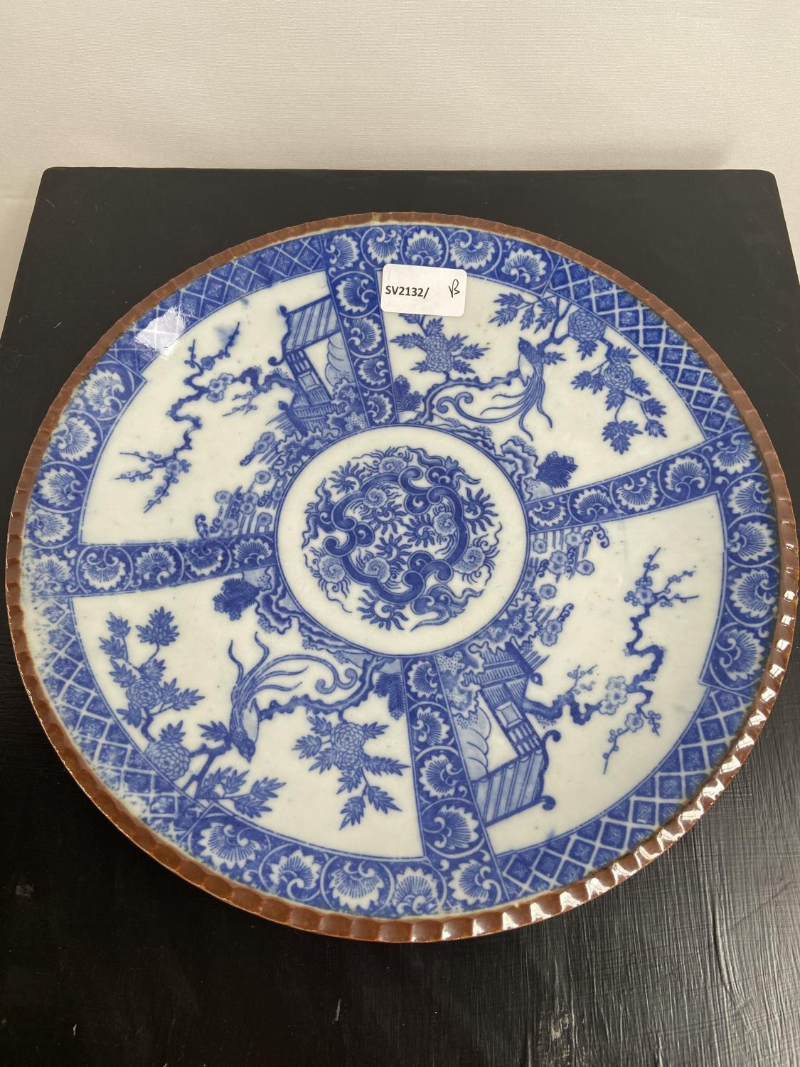 A Japanese blue and white design charger, showing Yamatoku impressed marking to the base. [