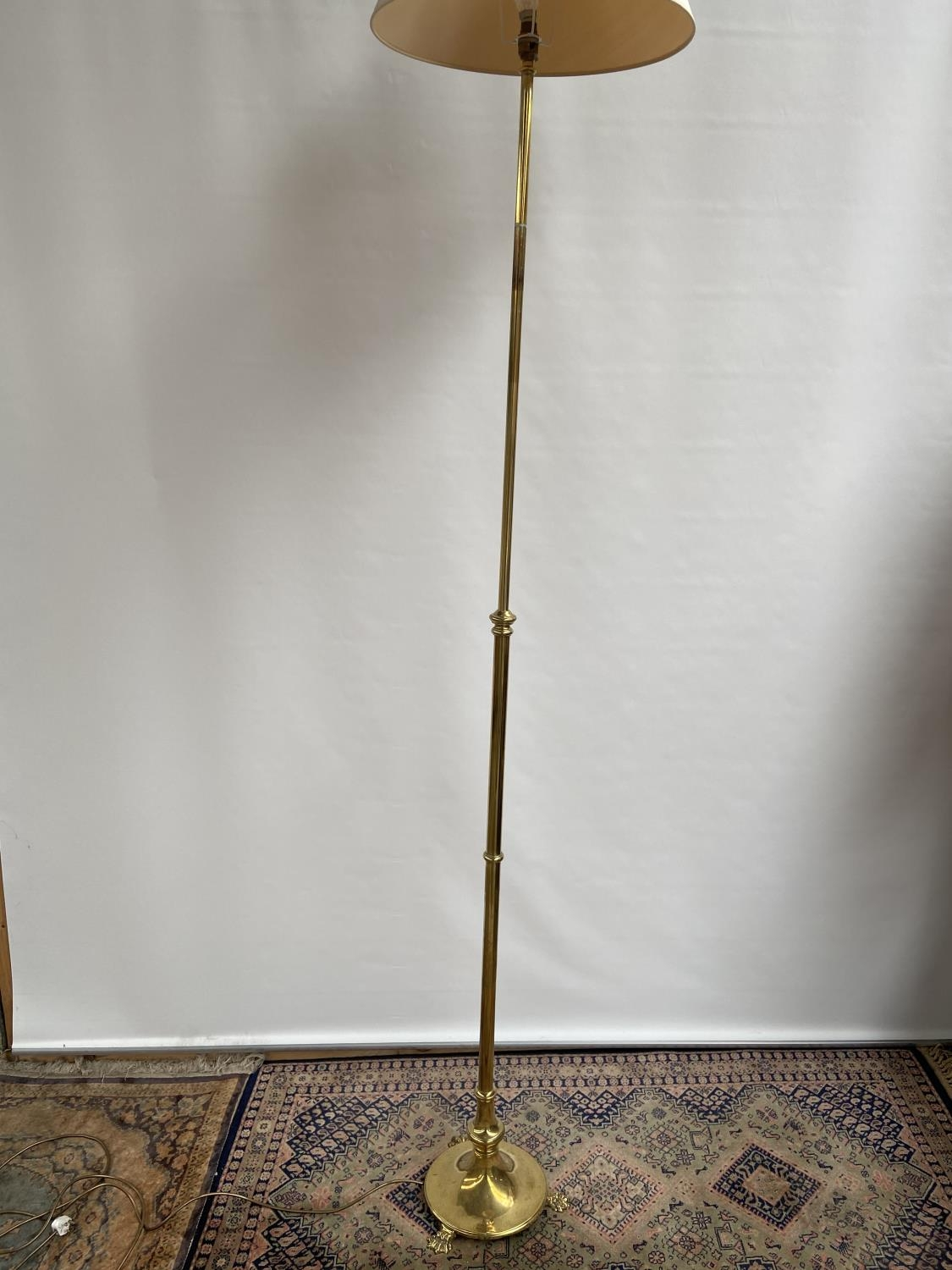 Antique heavy gilt brass rise and fall standard lamp. [height 173cm] [220cm]
