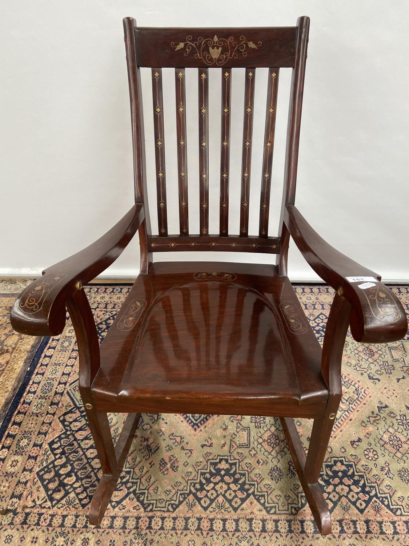 A Hardwood and brass inlaid rocking arm chair. [80x50x40cm] Originally from Saudi Arabia. - Image 3 of 3