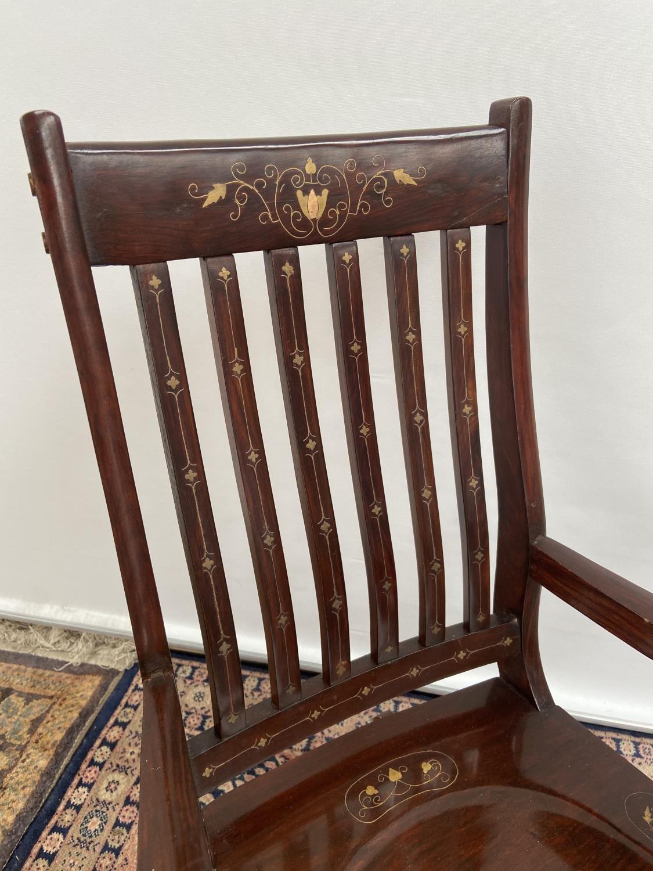 A Hardwood and brass inlaid rocking arm chair. [80x50x40cm] Originally from Saudi Arabia. - Image 2 of 3