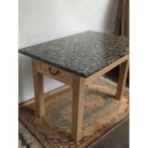 A contemporary table with single under drawer to each end and finished with a heavy granite top