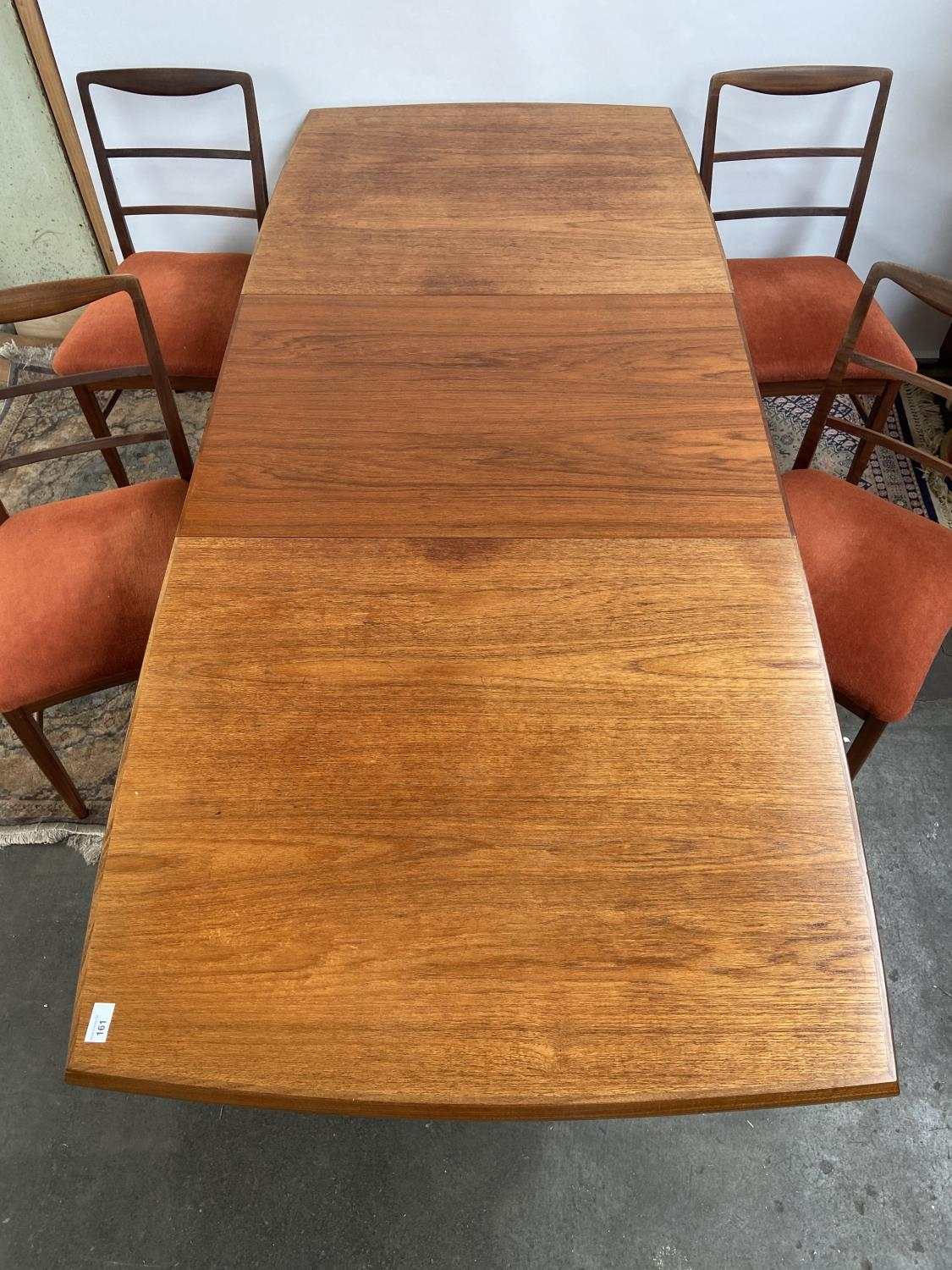 A Retro mid century teak dining table and four matching chairs produced by Vanson. [Table extended - Image 2 of 13