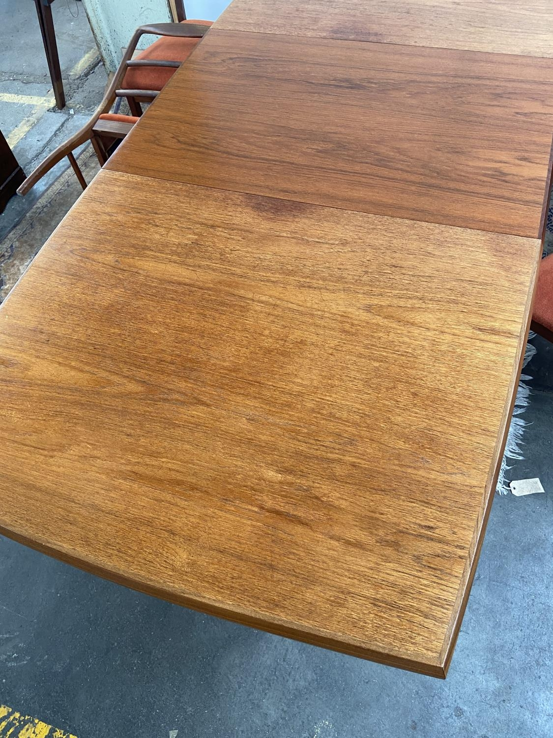 A Retro mid century teak dining table and four matching chairs produced by Vanson. [Table extended - Image 9 of 13