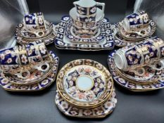 A Large part tea set produced by Sutherland. In an Imari style pattern.