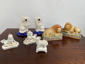 A Collection of antique Staffordshire animal figurines to include a pair of lions, Ram on a pedestal
