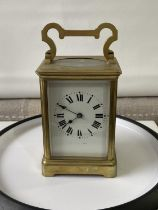 Antique heavy brass carriage clock [makers name unreadable] in a working order with double drum