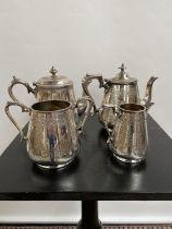 A Victorian four piece ornate tea/ coffee service.