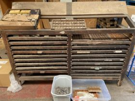 Antique industrial multi-drawer newspaper press unit, together with various lead lettering [141 x