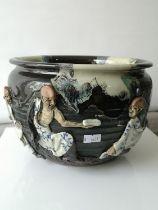 A Large antique Japanese Sumida Gawa ware urn bowl. Embellished with various raised three