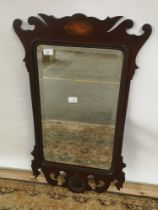 A Georgian bevel edged and bead trim wall mirror, hand carved frame with a centre design to the