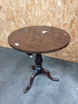 A 19th century mahogany circular flip top table supported on a tri leg [height, 67cm, diameter,