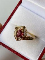 An 18ct gold ladies diamond & ruby set ring [size M] [4.13g]