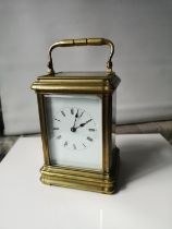 An antique heavy brass and glass carriage clock. In a working condition. [15x10x9cm]
